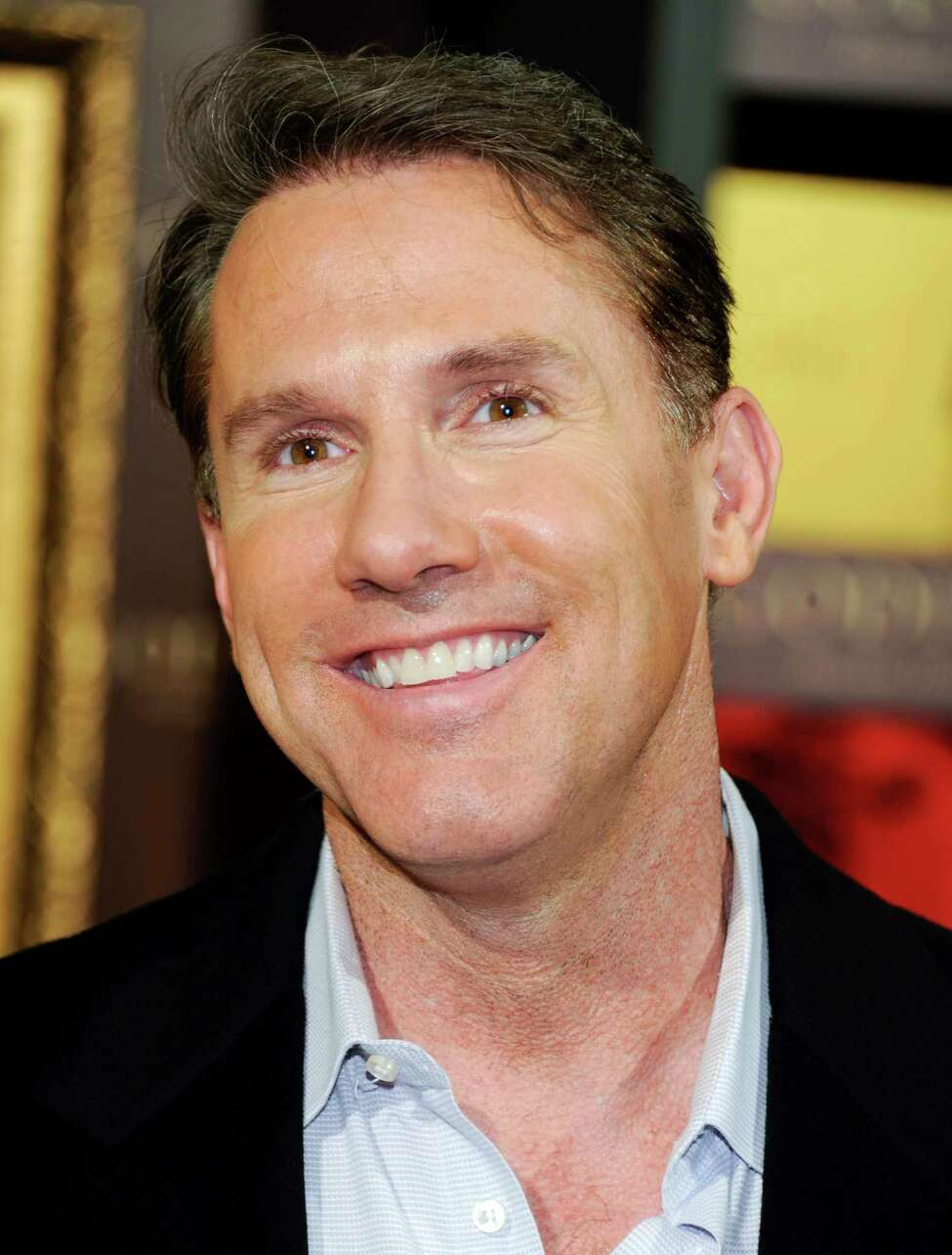 File- This Feb. 1, 2012 file photo shows author Nicholas Sparks as he participates in announcing Godiva's Valentine's Day