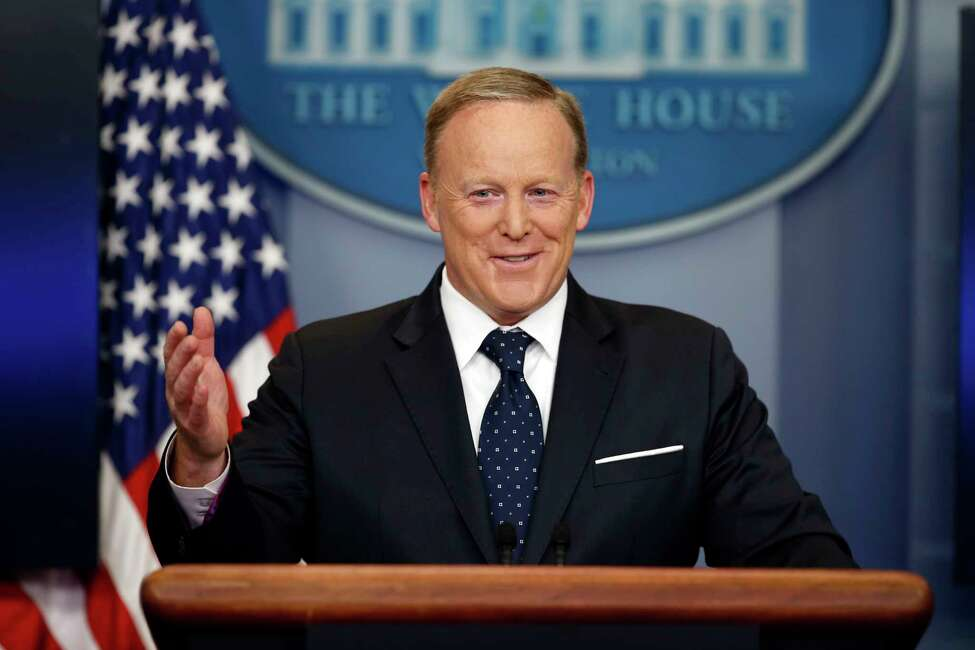 FILE - In this Tuesday, June 20, 2017, file photo, then-White House press secretary Sean Spicer smiles as he answers a question during a briefing at the White House, in Washington. A black man has accused the former White House press secretary of calling him a racial slur when they were students at a Rhode Island prep school. Spicer was at a book signing in Middletown on Friday, July 27 to promote his new book reflecting on his time at the press podium for President Donald Trump. Cambridge, Mass., resident Alex Lombard yelled out Spicera€™s name and accused Spicer of calling him the N-word and trying to fight him when they attended Portsmouth Abbey School.(AP Photo/Alex Brandon, File)