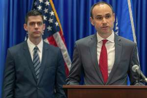 David Morrell, at the lectern, Deputy Assistant Attorney General of the Department of Justice Consumer Protection Branch, speaks Wednesday, Aug. 21, 2019, as U.S. Attorney John Bash listens. The officials spoke about the arrest of five people on charges that they stole millions of dollars from elderly and disabled veterans and active service members in a scheme that used stolen identity information to access Department of Defense and Veteran Affairs benefit websites. Bash and his assistants will be prosecuting the case.