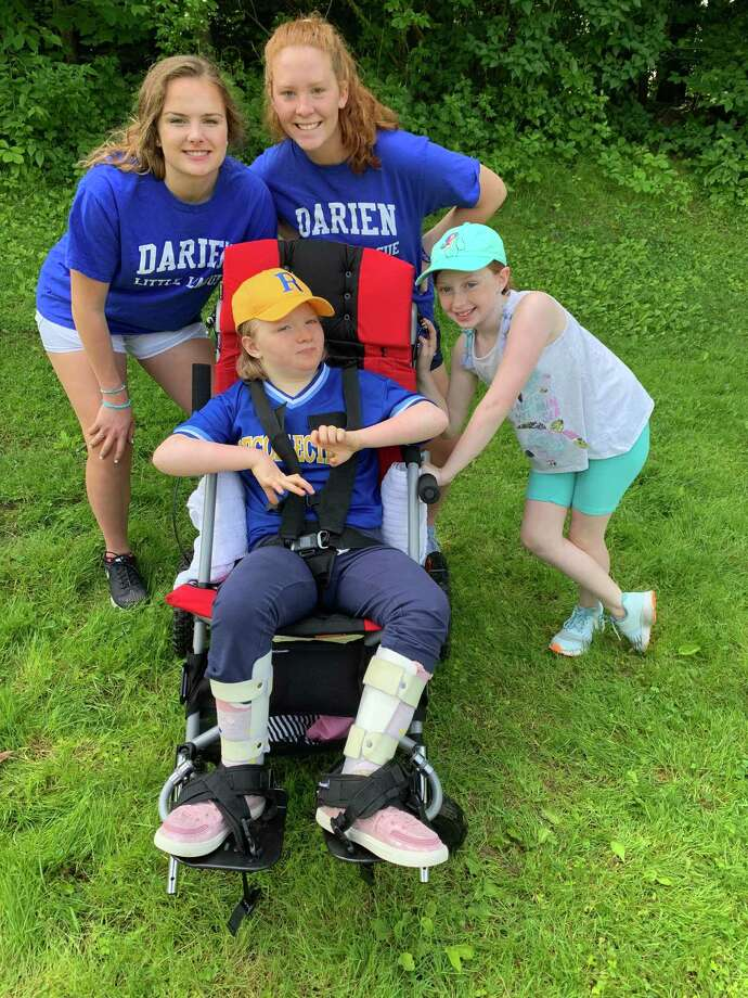 Charlotte and her Challenger Baseball Buddies (Nicole Clark and Sally Carter) and sister Claire, Darien Little League Photo: Contributed Photo / Connecticut Post