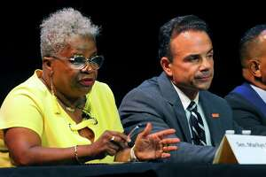 State Senator Marilyn Moore, left, takes part in the 2019 Bridgeport Mayoral Forum at Klein Memorial Auditorium in Bridgeport, Conn., on Wednesday August 21, 2019. Seated next to Moore is incumbent Mayor Joe Ganim. The forum is sponsored by AARP Connecticut and Bridgeport Generation Now.