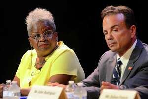 State Senator Marilyn Moore, left, and Mayor Joe Ganim at a Bridgeport mayoral forum at Klein Memorial Auditorium in August.