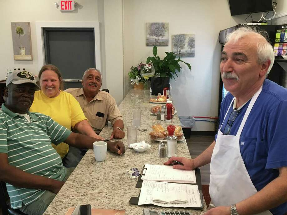 The new Route 80 Cafe may only have been open at 697 Foxon Road in East Haven for a few weeks, but under the guidance of owner Bill Kalogeridis, right, who for many years owned the Copper Kitchen in downtown New Haven, it's already well-seasoned. Visiting for lunch on Wednesday were, from left, retired New Haven Police Department Det. Joe Greene, Gail Simon and Mike Streeto. Photo: Mark Zaretsky / Hearst Connecticut Media /