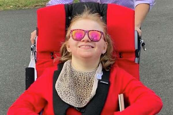 Charlotte enjoying a walk in her stroller, in Darien
