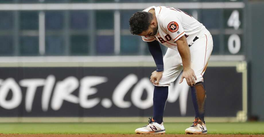 Houston Astros Jose Altuve (27) reacts after getting tagged out by Detroit Tigers third baseman Dawel Lugo after Yuli Gurriel hit into a double play during the eighth inning of an MLB game at Minute Maid Park, Wednesday, August 21, 2019. Photo: Karen Warren/Staff Photographer