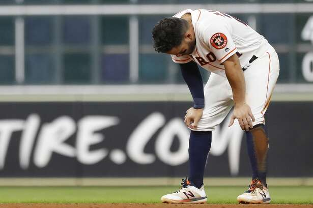 Houston Astros Jose Altuve (27) reacts after getting tagged out by Detroit Tigers third baseman Dawel Lugo after Yuli Gurriel hit into a double play during the eighth inning of an MLB game at Minute Maid Park, Wednesday, August 21, 2019.