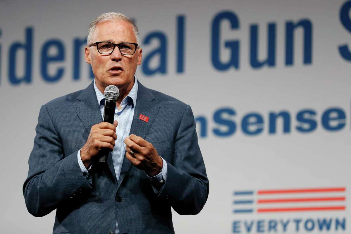 FILE - In this Aug. 10, 2019, file photo, Democratic presidential candidate Washington Gov. Jay Inslee speaks at the Presidential Gun Sense Forum in Des Moines, Iowa. Inslee, who made fighting climate change the central theme of his presidential campaign, announced Wednesday night, Aug. 21, that he is ending his bid for the 2020 Democratic nomination. (AP Photo/Charlie Neibergall, File)
