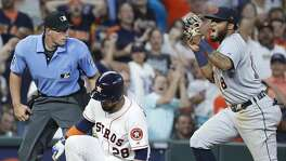 Detroit Tigers third baseman Dawel Lugo (18) reacts after tagging Houston Astros Robinson Chirinos (28) out at third base after Chirinos tried to stretch his double into a triple to end the ninth inning of an MLB game at Minute Maid Park, Wednesday, August 21, 2019.