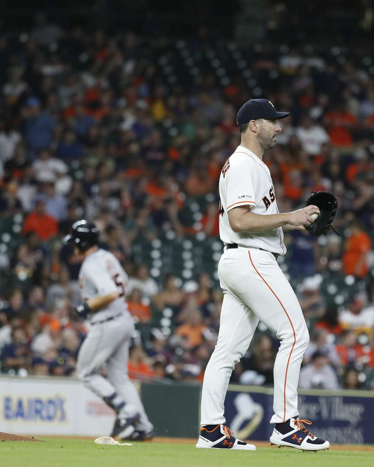 Houston Astros starting pitcher Justin Verlander (35) reacts as Detroit Tigers John Hicks runs the bases after his home run during the ninth inning of an MLB game at Minute Maid Park, Wednesday, August 21, 2019.