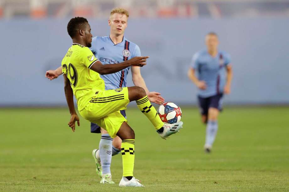 Columbus Crew forward David Accam (29), left, controls the ball in front of New York City FC midfielder Gary Macay-Steven during the first half of an MLS soccer match, Wednesday, Aug. 21, 2019, in New York. (AP Photo/Kathy Willens) Photo: Kathy Willens / Copyright 2019 The Associated Press. All rights reserved.