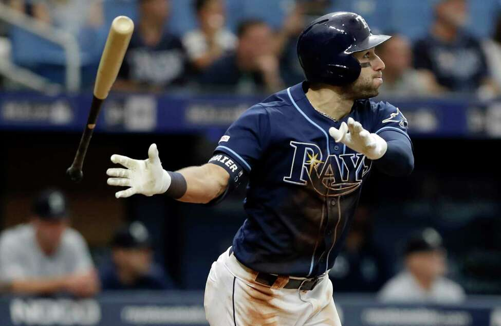 Tampa Bay Rays' Kevin Kiermaier flips his bat as he watches his home run off Seattle Mariners relief pitcher Matt Magill during the ninth inning of a baseball game Wednesday, Aug. 21, 2019, in St. Petersburg, Fla. (AP Photo/Chris O'Meara)