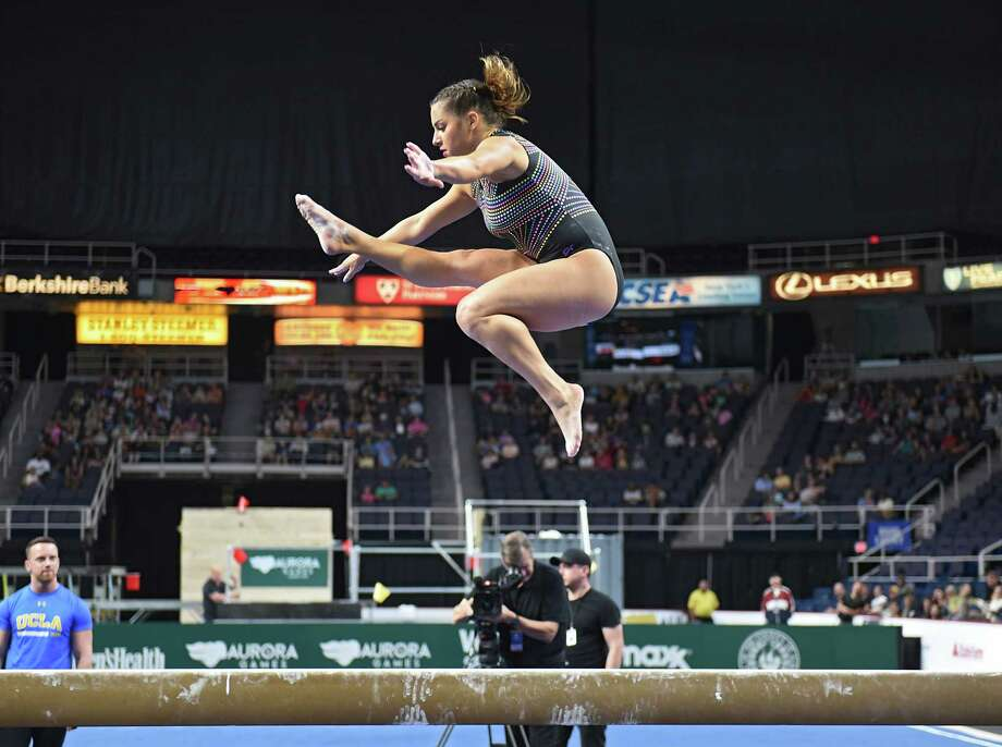 McKenna Kelly performs on the balance beam gymnastics event at the Aurora Games held at the Times Union Center on Wednesday, Aug. 21, 2019 in Albany, N.Y. McKenna is the daughter of Olympic gold medal gymnast Mary Lou Retton. The balance beam was part one of the artistic event with floor exercise being second.(Lori Van Buren/Times Union) Photo: Lori Van Buren / 20047632A
