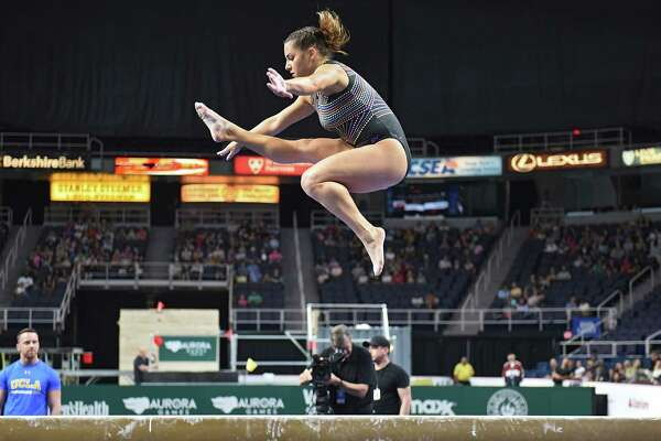 McKenna Kelly performs on the balance beam gymnastics event at the Aurora Games held at the Times Union Center on Wednesday, Aug. 21, 2019 in Albany, N.Y. McKenna is the daughter of Olympic gold medal gymnast Mary Lou Retton. The balance beam was part one of the artistic event with floor exercise being second.(Lori Van Buren/Times Union)