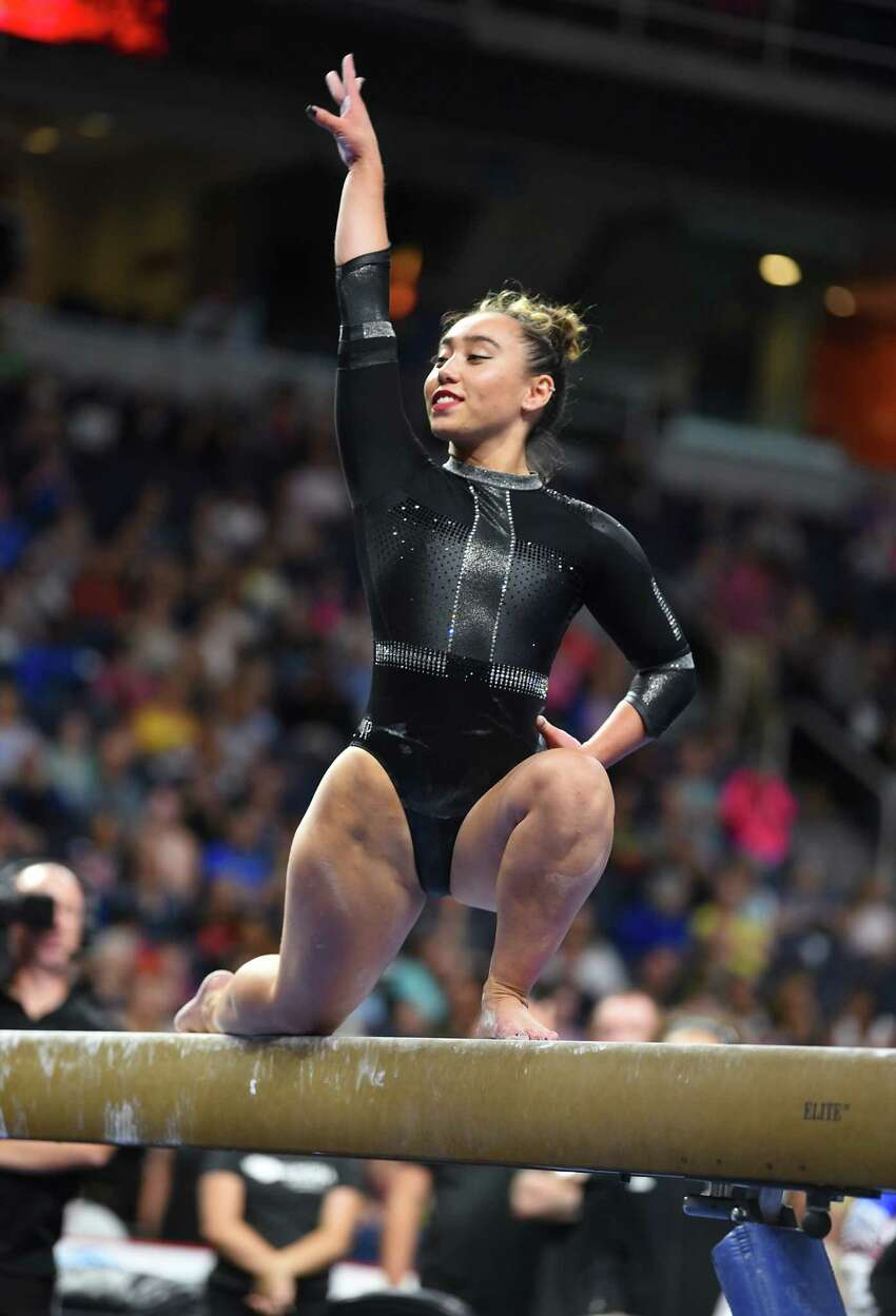 Team Americas' Katelyn Ohashi performs during the balance beam gymnastics event at the Aurora Games held at the Times Union Center on Wednesday, Aug. 21, 2019 in Albany, N.Y. The balance beam was part one of the artistic event with floor exercise being second.(Lori Van Buren/Times Union)