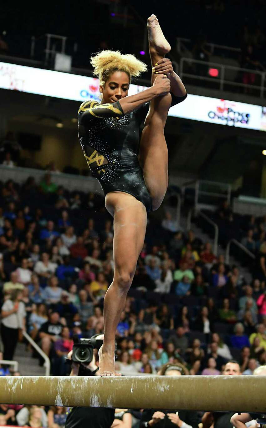 Team World's Danusia Francis performs during the balance beam gymnastics event at the Aurora Games held at the Times Union Center on Wednesday, Aug. 21, 2019 in Albany, N.Y. The balance beam was part one of the artistic event with floor exercise being second.(Lori Van Buren/Times Union)