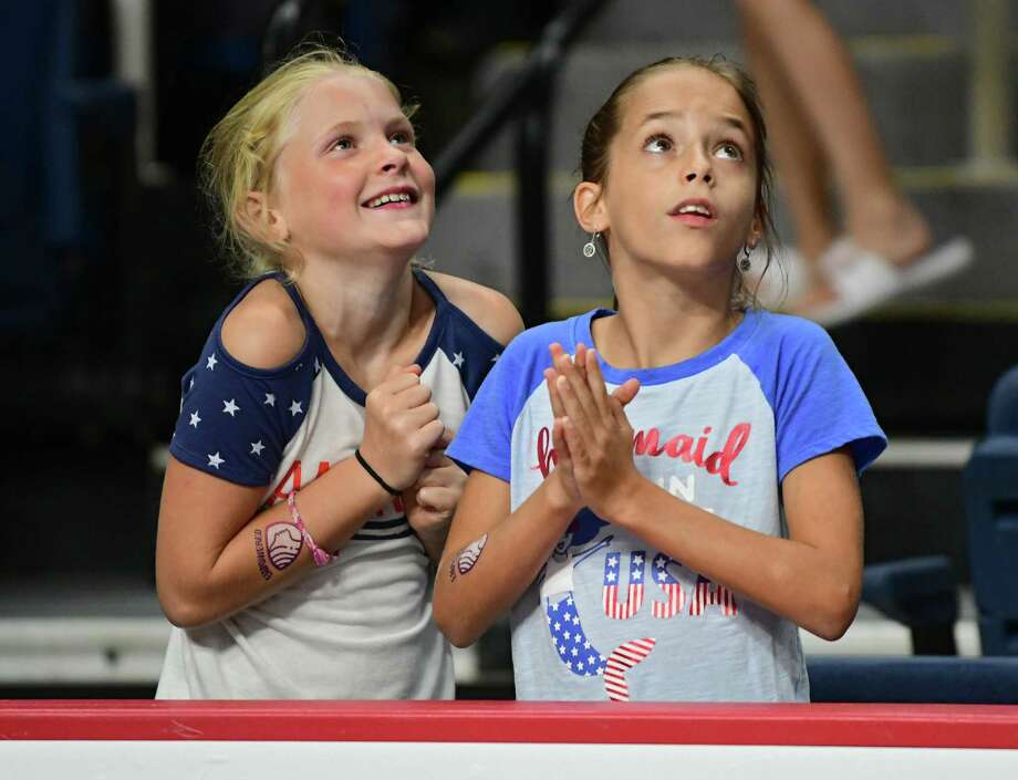 Two young fans were star struck before going back to their seats during the gymnastics event at the Aurora Games held at the Times Union Center on Wednesday, Aug. 21, 2019 in Albany, N.Y. (Lori Van Buren/Times Union) Photo: Lori Van Buren / 20047632A