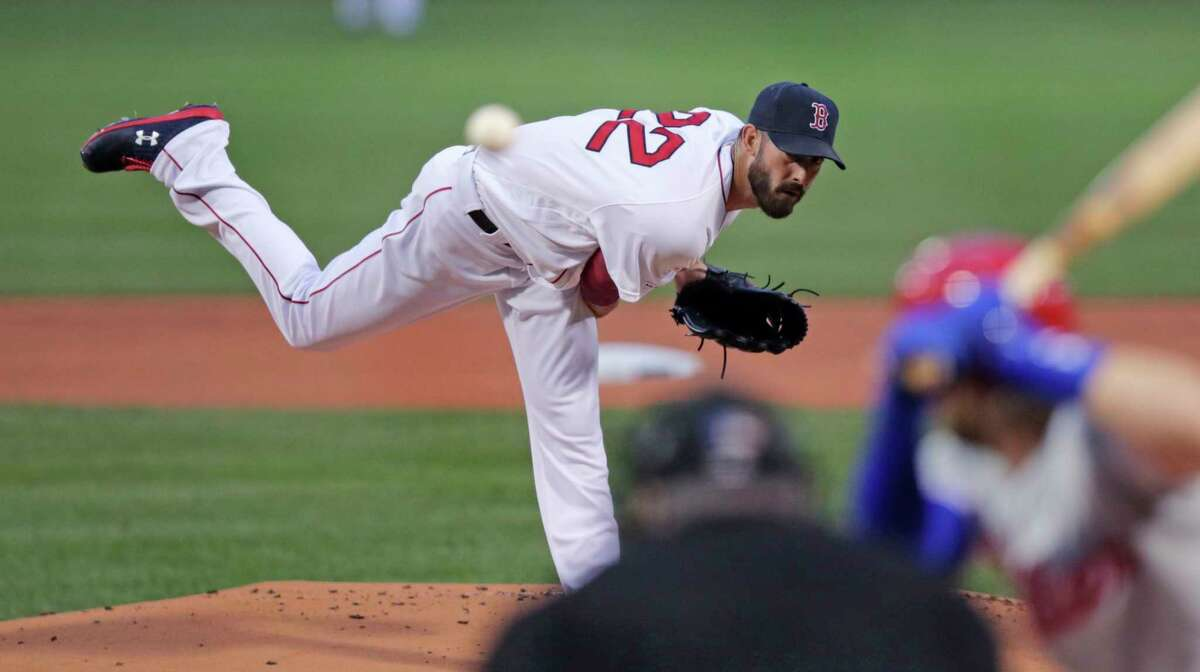 Boston Red Sox starting pitcher Rick Porcello delivers in the first inning during a baseball game against the Philadelphia Phillies at Fenway Park in Boston, Wednesday, Aug. 21, 2019. (AP Photo/Charles Krupa)