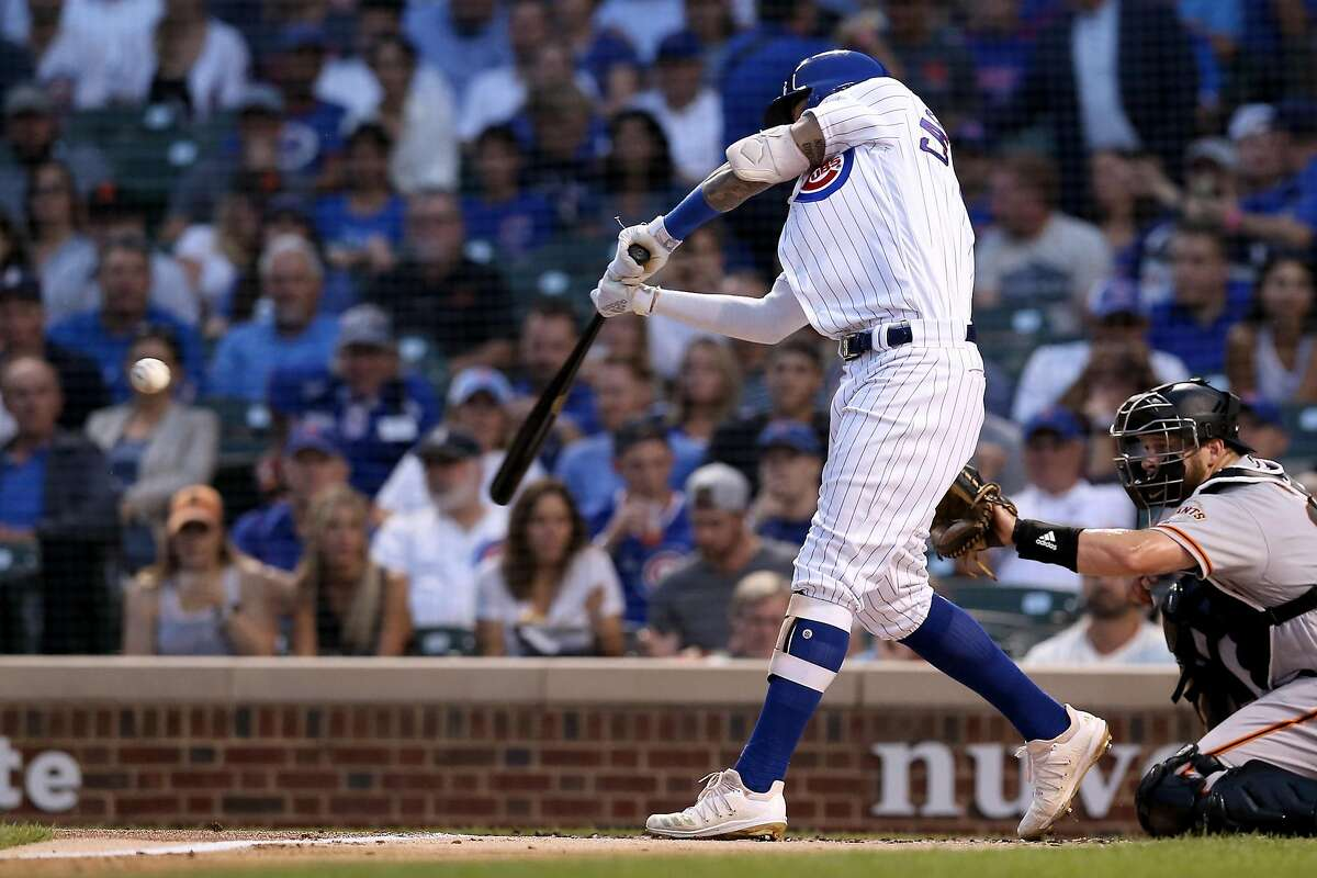 Nicholas Castellanosof the Chicago Cubs hits a home run in the first inning against the San Francisco Giants at Wrigley Field on Aug. 21, 2019.