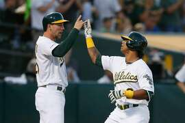 OAKLAND, CALIFORNIA - AUGUST 21: Khris Davis #2 of the Oakland Athletics celebrates with teammate Stephen Piscotty #25 after hitting a two-run home run in the bottom of the second inning against the New York Yankees at Ring Central Coliseum on August 21, 2019 in Oakland, California. (Photo by Lachlan Cunningham/Getty Images)