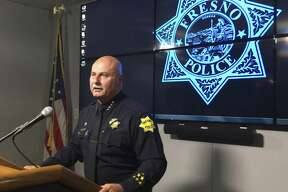 FILE - In this July 13, 2016 file photo, Fresno Police Chief Jerry Dyer speaks at a news conference after releasing body-camera video of officers fatally shooting a man in Fresno, Calif. Dyer said Friday, Dec. 9, 2016 that he's taking action against one of his officers involved in the fatalshooting of an unarmed 19-year-old man who refused repeated commands to show his hands during a traffic stop. (AP Photo/Scott Smith, File)