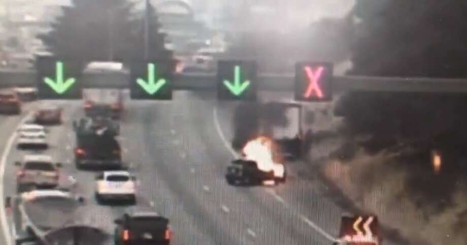A box truck and vehicle crashed Thursday morning before the vehicle caught fire. Two right lanes were blocked on northbound Interstate 5 near Michigan Street. Photo: Courtesy WSDOT