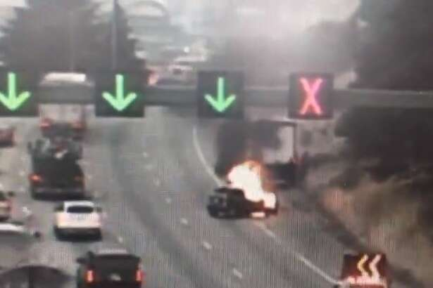 A box truck and vehicle crashed Thursday morning before the vehicle caught fire. Two right lanes were blocked on northbound Interstate 5 near Michigan Street.