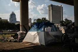 A tent encampment under Interstate 35 near downtown Austin on Aug. 14.