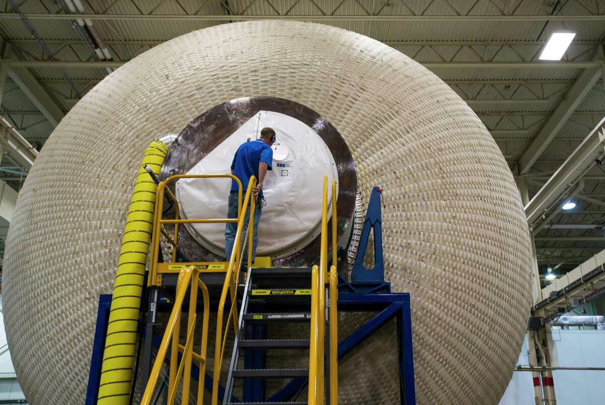 The exterior of Sierra Nevada Corporation's prototype for an inflatable space habitat that could be used for NASA's lunar orbital platform gateway project is surrounded on the outside by a layer of Vectran fabric which provides the restraint layer for the pressurized module, during a press event at Johnson Space Center in Houston, Wednesday, Aug. 21, 2019. The habitat as currently modeled consists of three floors outfitted for a crew of four astronauts.