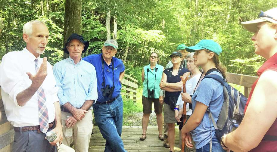 State Sen. Norm Needleman, D-Essex, left, speaks during a bird walk with U.S. Congressman Joe Courtney and representatives from groups including Audubon Connecticut. Photo: Contributed Photo