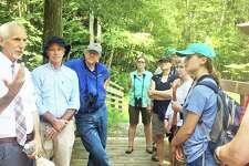 State Sen. Norm Needleman, D-Essex, left, speaks during a bird walk with U.S. Congressman Joe Courtney and representatives from groups including Audubon Connecticut.