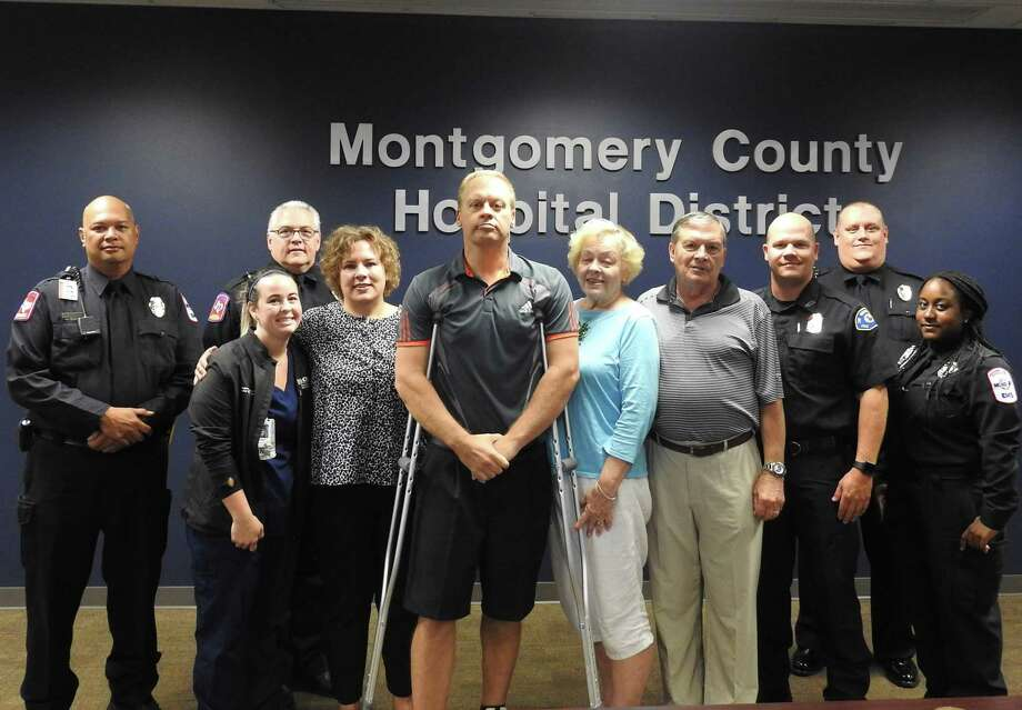 Tom Dreier stand at center surrounded by family and Montgomery County Hospital District personnel who helped save his life after he suffered a cardiac arrest while driving in The Woodlands. Photo: Courtesy Of The Montgomery County Hospital District