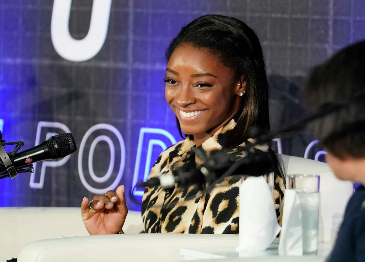 Simone Biles with her mom, Nellie Biles, right, talk with Andrew Hawkins, host and former NFL player, for a podcast at Chase bank, 712 Main, Wednesday, Aug. 21, 2019, in Houston. Chase sponsors media company Uninterrupted's Kneading Dough video series and Branching Out podcast series.