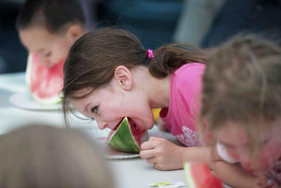 The watermelon-eating contest will be back at this year's Cannon Grange Agricultural Fair on Sunday, Aug. 25. Photo: Bryan Haeffele / Hearst Connecticut Media / Wilton Bulletin