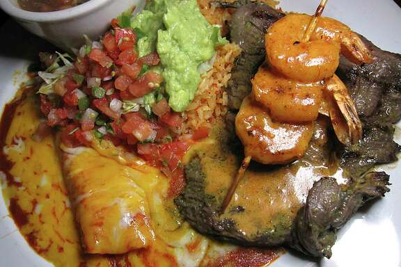 Arachera Marisol is a grilled skirt steak with shrimp, crema de chipotle, rice, borracho beans and a cheese enchilada at Aldaco's Mexican Cuisine.