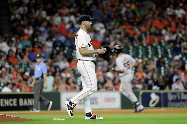Houston Astros starting pitcher Justin Verlander walks off the mound after giving up a home run to Detroit Tigers' John Hicks (55) during the ninth inning of a baseball game Wednesday, Aug. 21, 2019, in Houston. (AP Photo/David J. Phillip)