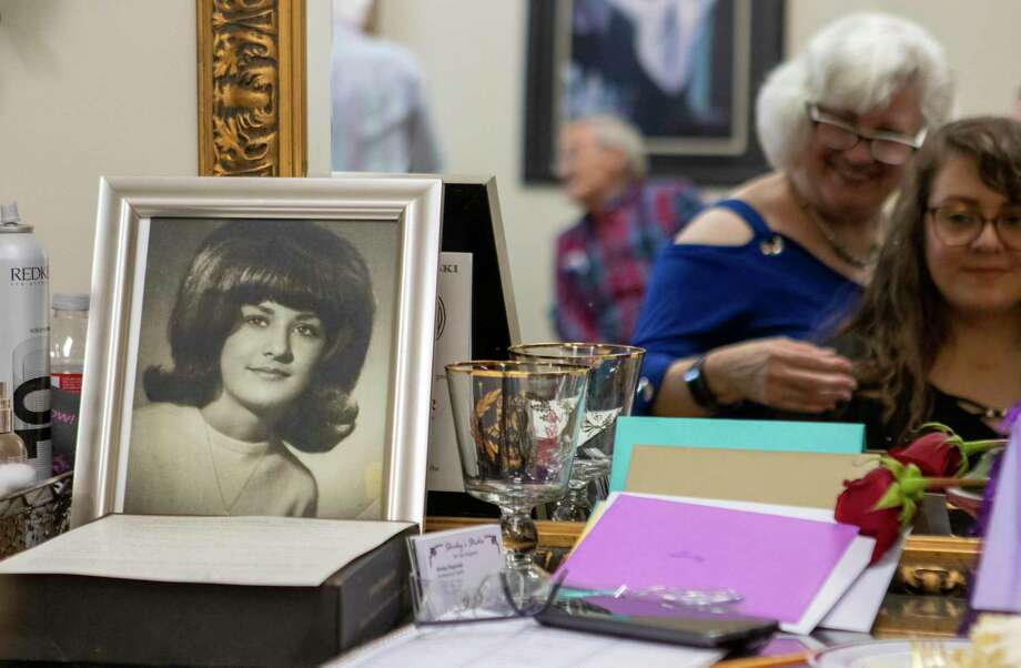 A portrait of Shirley Rogowski during her senior year of high school rests at her beauty station Wednesday, August 21, 2019 at R & K Hair in Conroe. Rogowski recently celebrated her 50th work anniversary as a hairstylist. Photo: Cody Bahn, Houston Chronicle / Staff Photographer / © 2019 Houston Chronicle