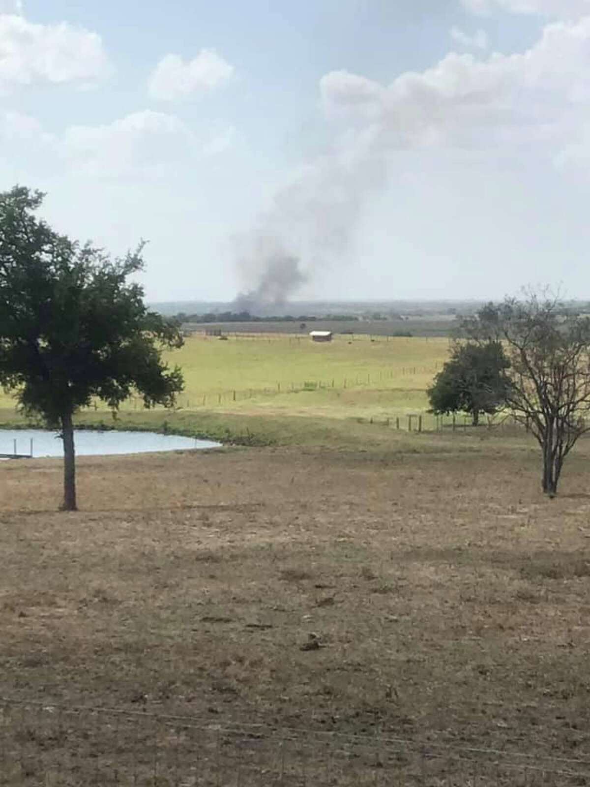 York Creek fire officials responding to a 100-acre wildfire in Kingsbury on Aug. 18 photograph a plume of smoke from the fire 25 miles away.
