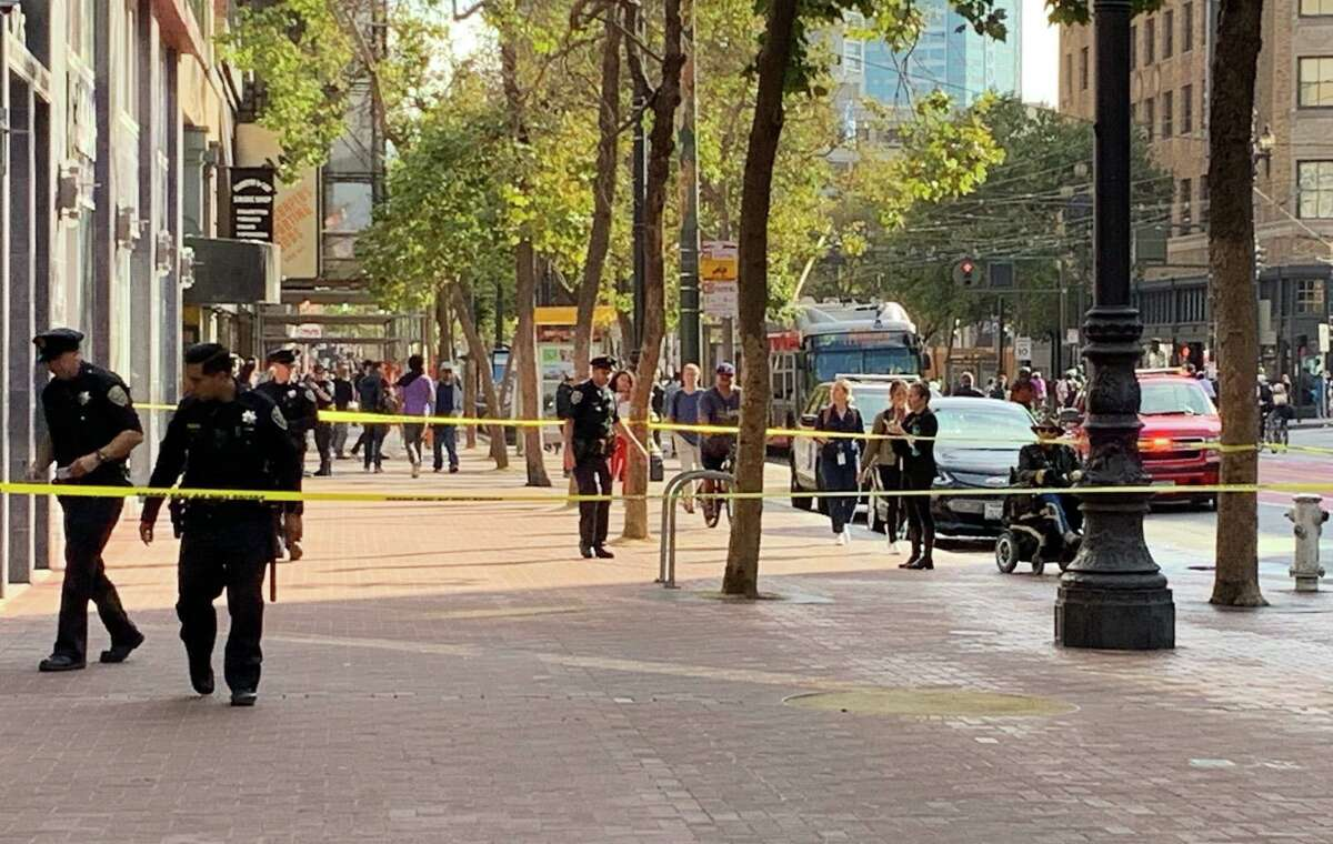 San Francisco police are seen investigating Tuesday's shooting at Sixth and Market streets, which left one person injured.
