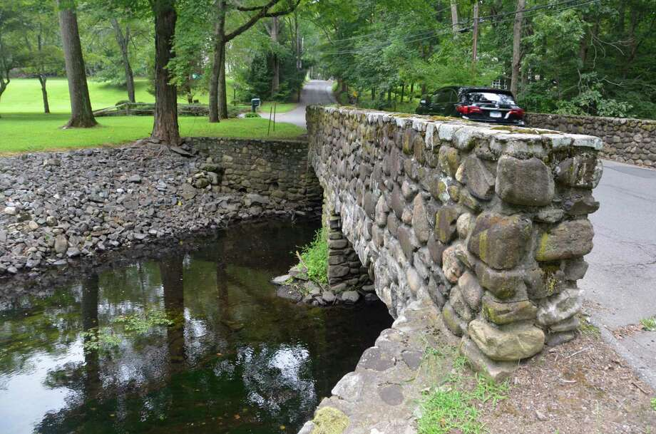 The bridge that carries Flax Mill Lane over the Wepawaug River in Milford, Conn. is scheduled to be replaced in 2020. Photo: Jill Dion / Hearst Connecticut Media