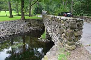 The bridge that carries Flax Mill Lane over the Wepawaug River in Milford, Conn. is scheduled to be replaced in 2020.