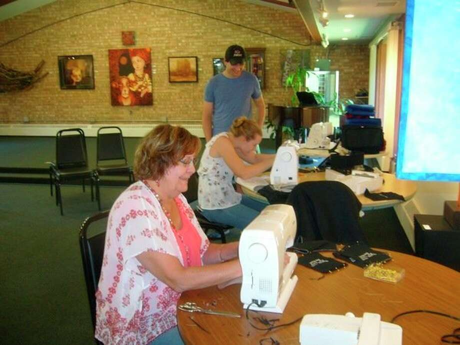 Volunteers sew lap robes and blankets for veterans on Saturday, Aug. 17 at Creative 360. (Photo provided)