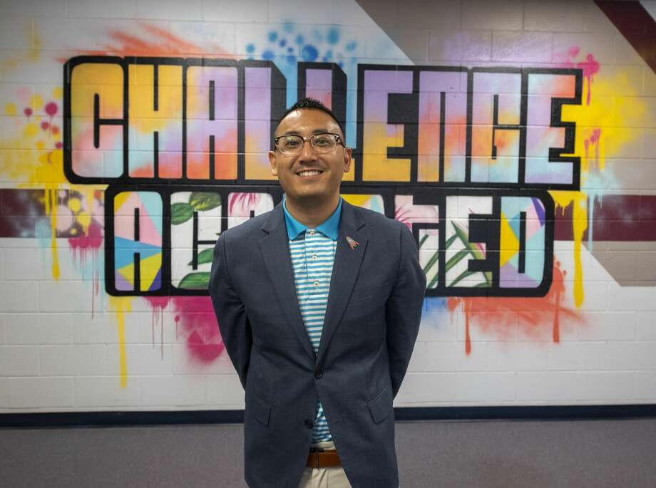 Principal Aaron Fong poses in front of the Challenge Accepted mural on Wednesday, August 22, 2019 at Bush Elementary School. Photo: Jacy Lewis/Reporter-Telegram