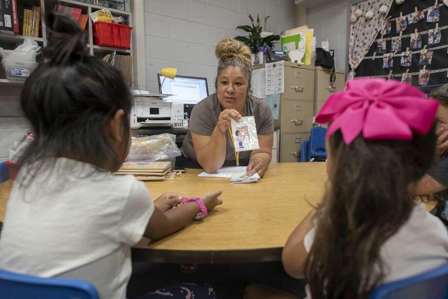 Stephanie Herrera teaches her prekindergarten class about the morning routine Wednesday, August 22, 2019 at Bush Elementary School. Photo: Jacy Lewis/Reporter-Telegram