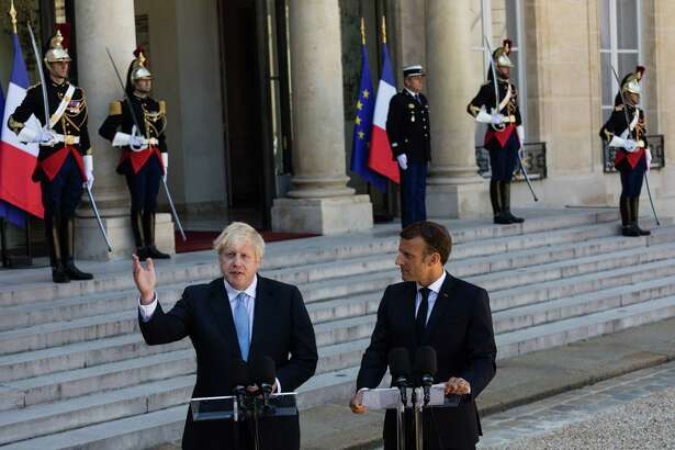 U.K. Prime Minister Boris Johnson meets with French President Emmanuel Macron in the courtyard of Elysee Palace in Paris on Thursday, Aug. 22, 2019.