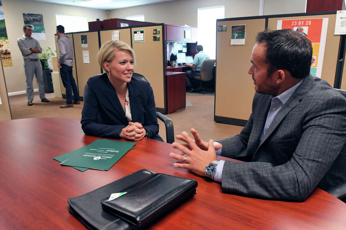 Miriam Dushane, left, managing partner at Alaant Workforce Solutions, meets with Mario Pecoraro, CEO of Alliance Worldwide Investigative Group, on Wednesday, Aug. 7, 2019, in Clifton Park, N.Y. (Paul Buckowski/Times Union)
