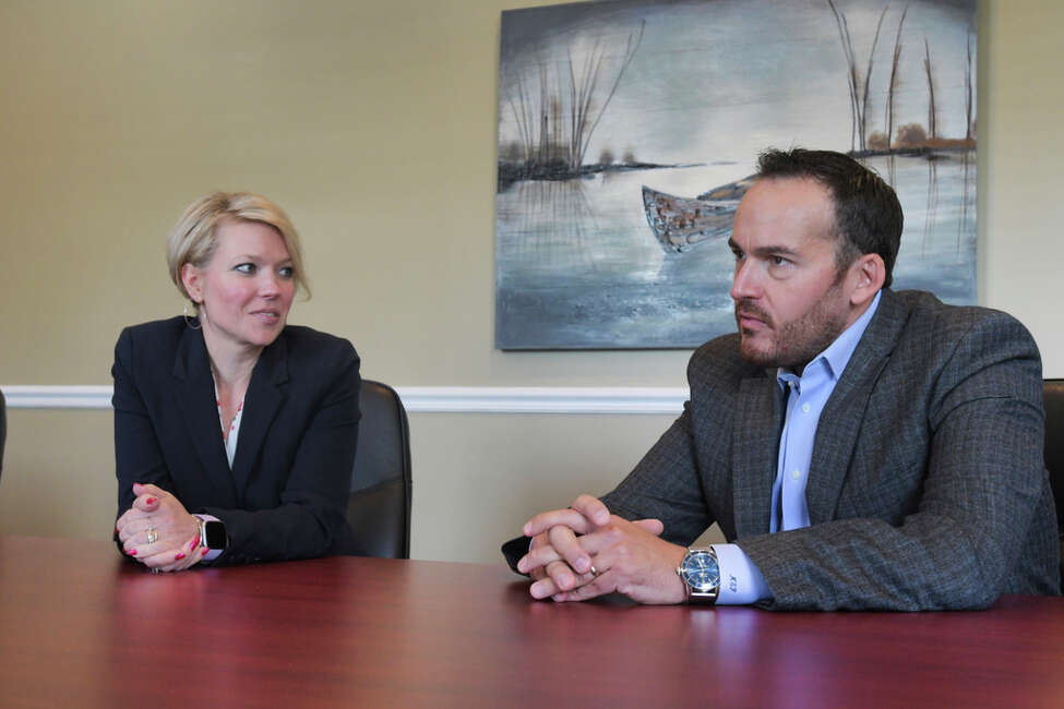 Miriam Dushane, left, managing partner at Alaant Workforce Solutions, and Mario Pecoraro, CEO of Alliance Worldwide Investigative Group, are interviewed on Wednesday, Aug. 7, 2019, in Clifton Park, N.Y. (Paul Buckowski/Times Union)