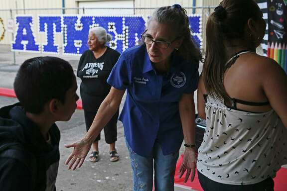 South San Antonio Independent School Board of Trustees President Connie Prado greets students for the first day of classes at the newly reopened Athens Elementary School, Aug. 19.