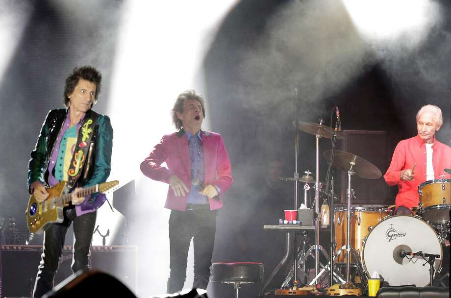 FILE - Mick Jagger and Ronnie Wood on stage with Charlie Watts, rirght, as the Rolling Stones performed during the No Filter Tour at Levi's Stadium in Santa Clara, Calif., on Sunday, August 18, 2019. The iconic English rock band's site promoter and production manager, as well as its security coordinator, recently penned heated letters to the stadium's last-minute rule changes and lack of provisions. Photo: Carlos Avila Gonzalez, The Chronicle