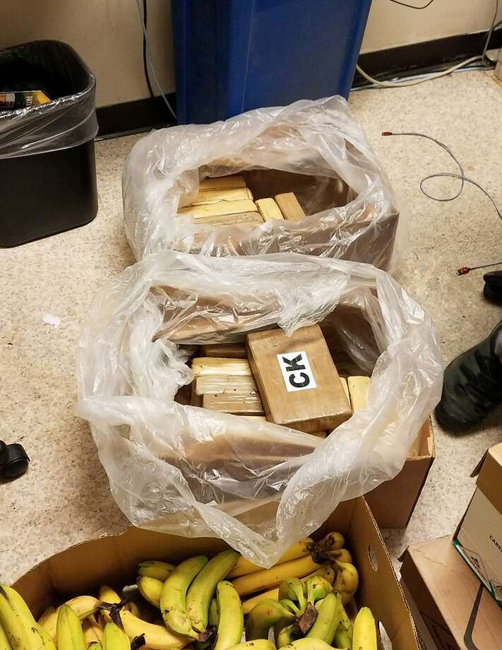 Bricks of cocaine wrapped in brown paper were discovered inside boxes of bananas delivered to Safeway stores in Washington earlier this week. Photo: Courtesy KCSO