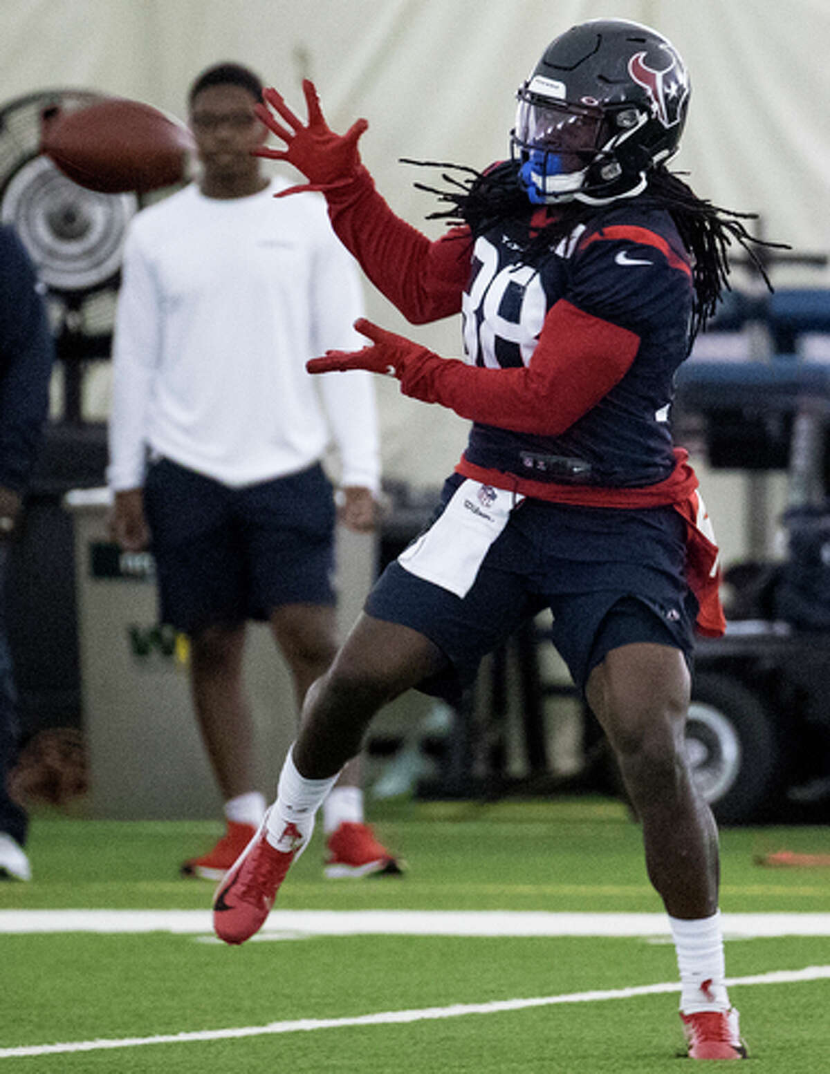 Houston Texans running back Buddy Howell reaches back to make a catch during training camp at the Methodist Training Center on Thursday, Aug. 22, 2019, in Houston.